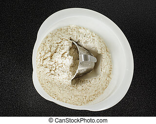 Measurement tool in a bowl of wheat flour