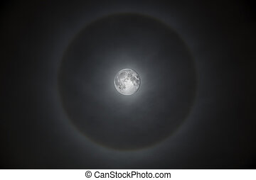 Magnificent full moon with misty halo - Full moon surrounded...