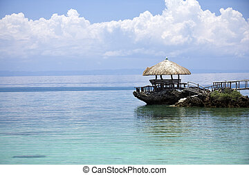 Tropical Island Hut - A tropical sea view with a small...