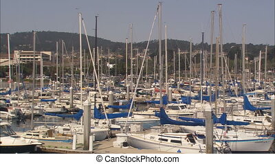 LS Monterey Harbor pan - LS of boats docked at Monterey...
