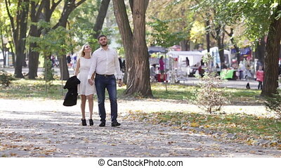 Couple on walk - Camera accompanies young couple walking