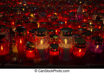 Many lighted candles - A lot of lighted candles on All...