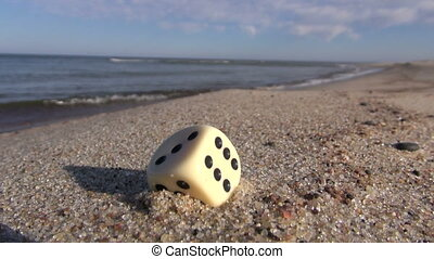 dice with number six  on beach