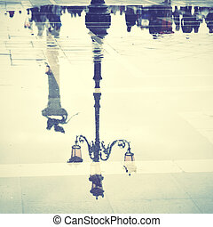 Venice reflects in puddle Saint Marks square, Italy Retro...