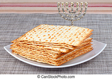 matzot - Closeup of Matzah on Plate which is the unleavened...