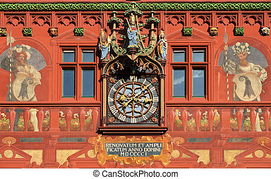 Clock on the wall of the city hall in Basel, Switzerland