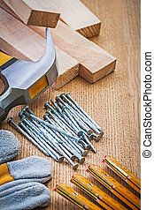 set of carpentry tools on wooden board