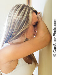 Blonde unhappy woman at home - Crying lonely young woman...