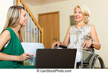 Insurance agent and disabled woman - Friendly insurance...