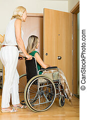 Happy women in wheelchair