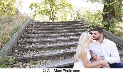 Couple sitting on stairs