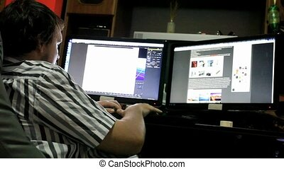 Late night office worker working overtime in dark office HD...