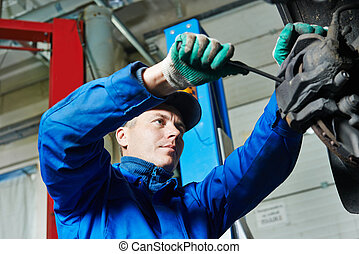 auto mechanic at car suspension repairing