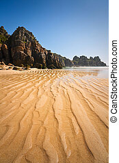 Porthcurno beach in Cornwall, UK. - Porthcurno beach in low...