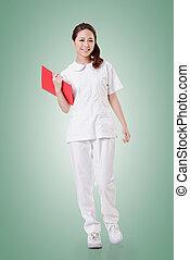 Attractive Asian nurse, woman portrait.Full length.