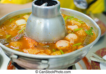 Thai hot and spicy soup seafood with fishballs and...