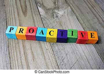 concept of proactive word on wooden colorful cubes