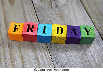 concept of friday word on wooden colorful cubes
