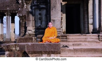 khmer monk meditating - cambodian monk in angkor wat temple