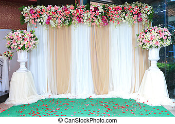 Colorful backdrop flowers with white and gold fabric...