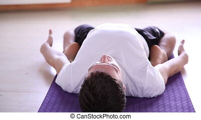 young  male doing yoga  - young and handsome male doing yoga