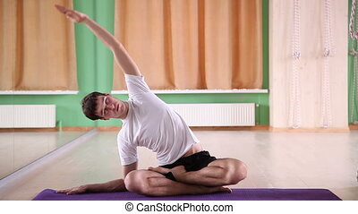 young and handsome man doing yoga