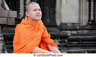 khmer monk smoking a cigarette - cambodian monk smoking in...