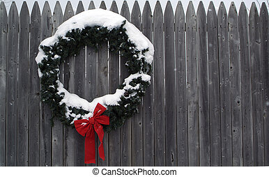Christmas wreath background - Christmas wreath on a fence as...