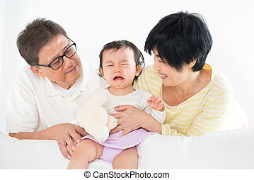 Asian family with crying baby