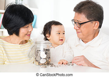 Asian family financial planning - Asian family saving money...
