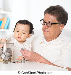 Asian family saving money - Asian family saving coins...