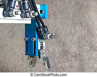 Robot hand grip. - Back view Aluminum pneumatic robot hand...