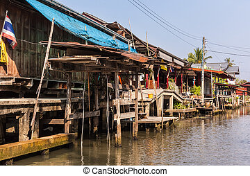 Ratchaburi houses - hovels of a small village on the...