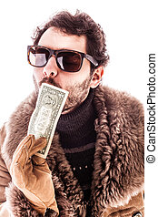 Dollar kiss - a young man wearing a sheepskin coat isolated...