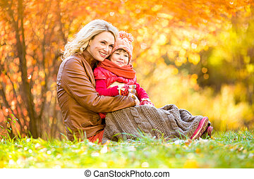Happy mother and child outdoor in autumn park - Happy mother...