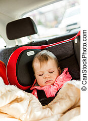 Sleeping - Cute baby girl sleeping in her car seat while...