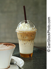 ice coffee with whipping cream in cafe
