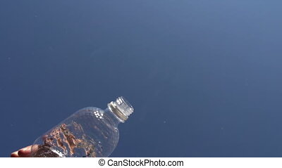 Water Flows from a Bottle - The camera looks straight up In...