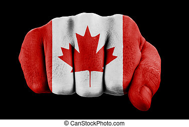 fist with canadian flag isolated on black