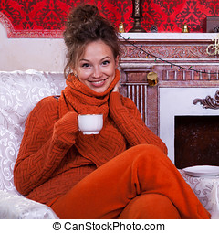 Beautiful girl inside a red vintage room with christmas decor