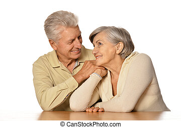 Happy senior couple isolated on white background