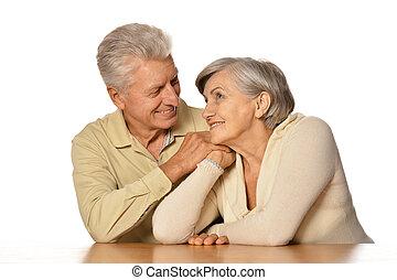 Happy senior couple isolated on white background