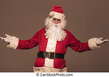 Portrait of Santa Claus welcoming you, on studio background