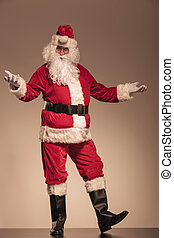 Santa Claus welcoming you - Full length picture of Santa...