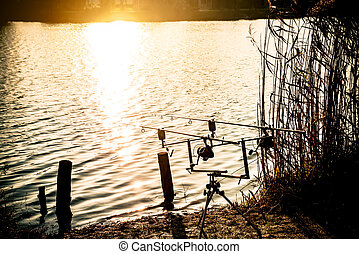 Fishing rod in the sunset at the lake.