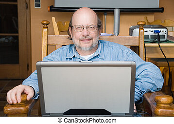 Senior professor with laptop - Senior mature bald multimedia...
