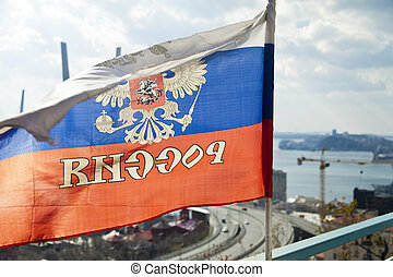 Russian flag - The Russian flag is rinsed on a wind under a...