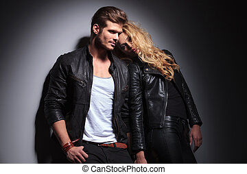 Blonde fashion woman leaning on her lover while he is...