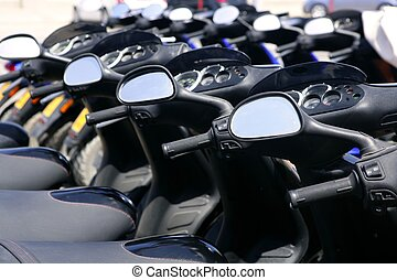 Scooter motorbikes in a row with perspective line