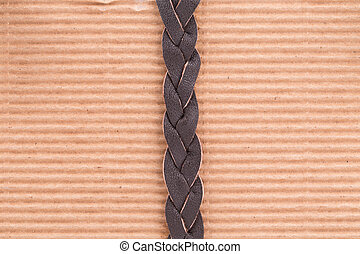 Woven brown leather belt Whole brown paper background